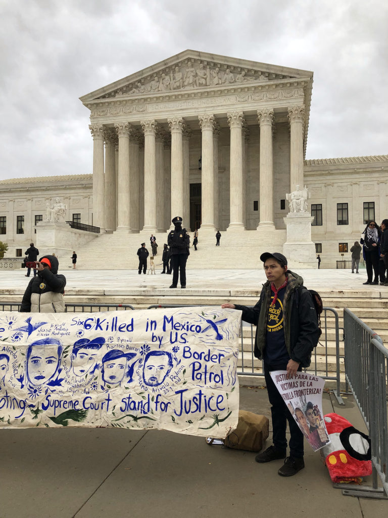 The author protests outside of the Supreme Court