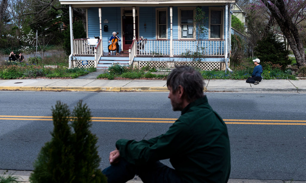 Cellist Jodi Beder performs a daily concert on her front porch in Mount Rainier, Maryland, near Washington, D.C., on March 30, 2020. Beder started the performances to help her neighbors, and passersby, cope with the coronavirus pandemic. Andrew Caballero-Reynolds/AFP/Getty Images)
