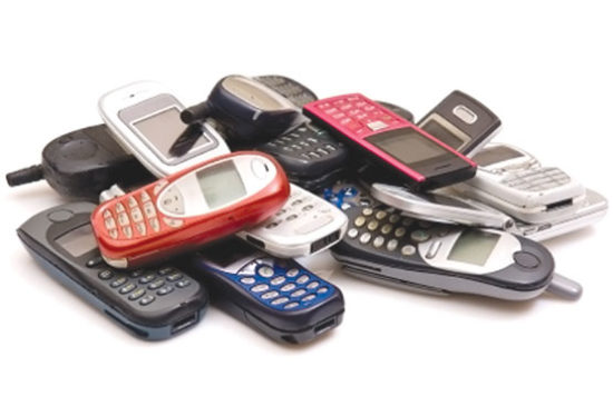 Cell Phone Pile by Shutterstock