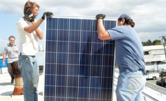 Installing photovoltaics by Everybody Solar.