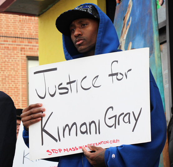 """Man with Sign that reads """"Justice for Kimani Gray"""""""