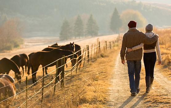 Couple walking by Shutterstock