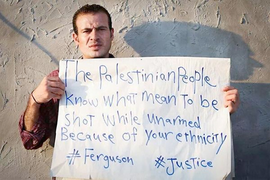 Palestinian in support of Ferguson protestors.