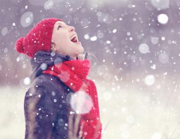 Woman in snow by Shutterstock