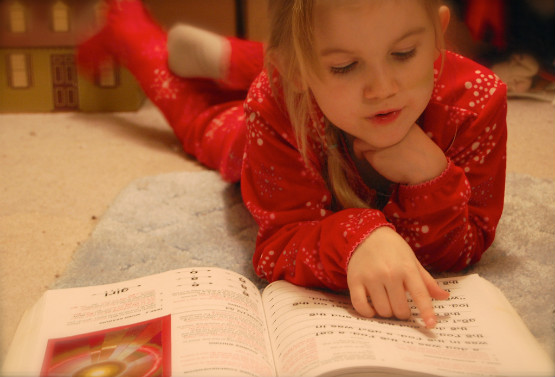 Learning to Read. Photo by The Real Estreya/ Flickr.